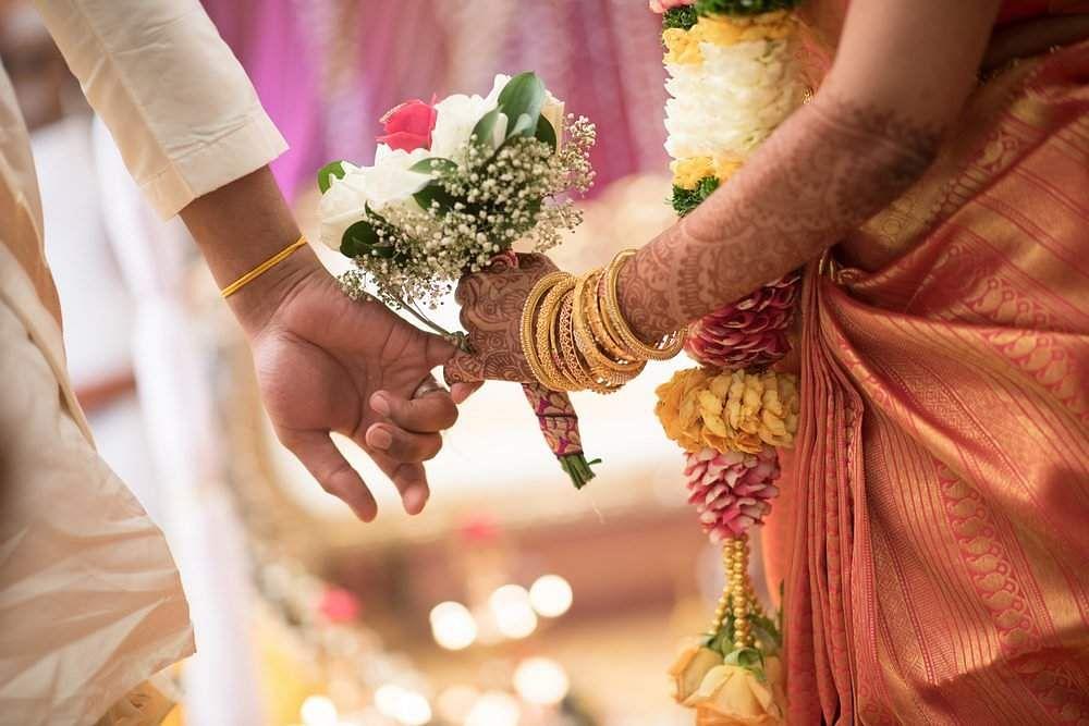 Indian-wedding-holding-hands