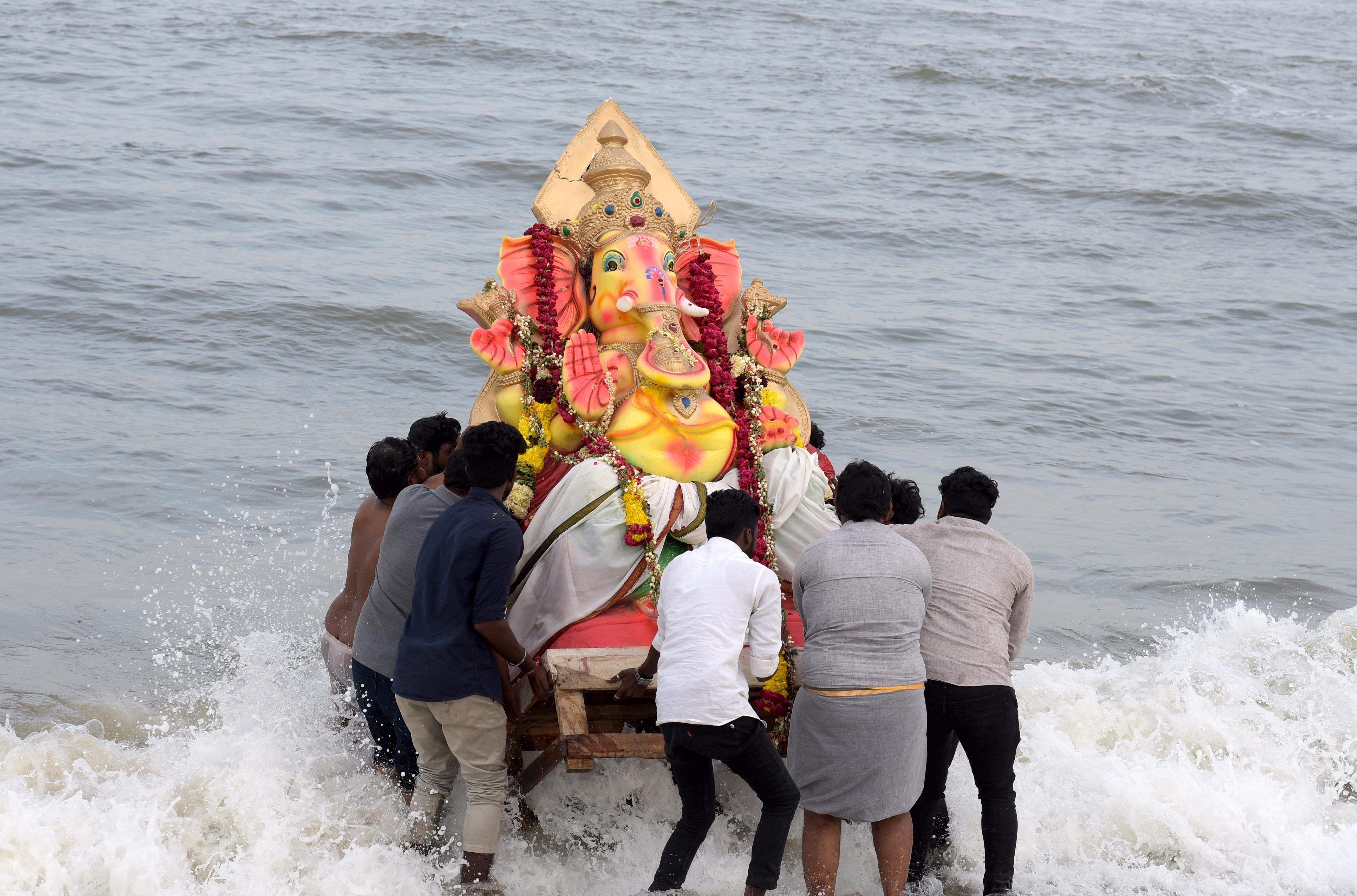 ganesh idols immersed in sea