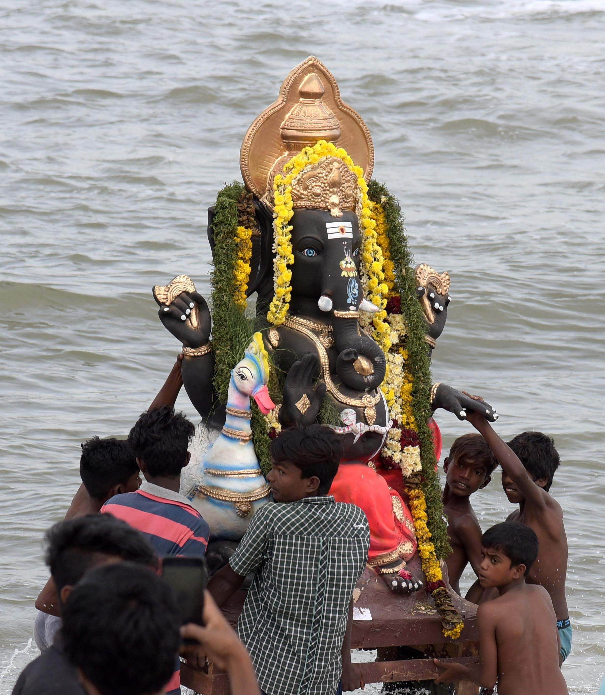 ganesh statue immersed in sea