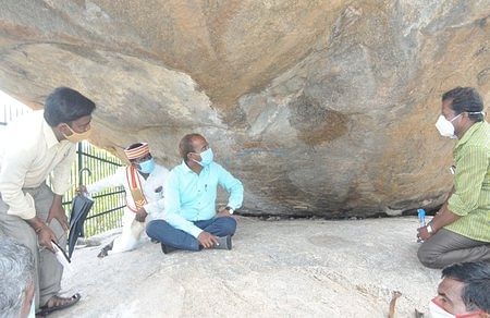 Rock Paintings: Collector inspects