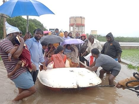 Rescue of people by boats from 50 flooded houses
