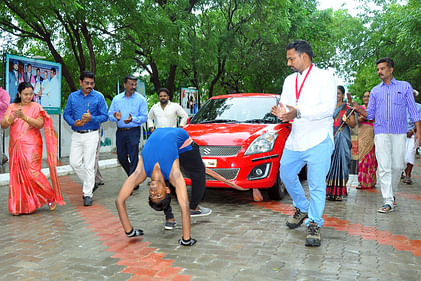 Student world record attempt by pulling the car on the wheel