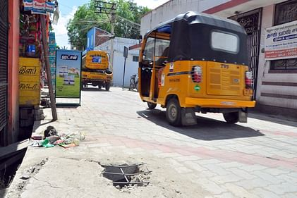 விருதுநகா் பா்மா காலனியில் உடைந்த நிலையில் உள்ள பாதாள சாக்கடைத் தொட்டி.