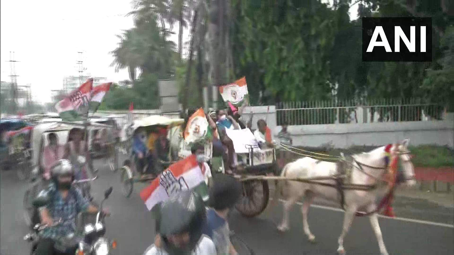 Patna: Congress workers ride bicycles, bullock cart and horse cart as a mark of protest against the increase in fuel prices.
