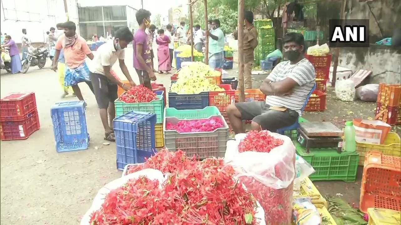 Chennai: A cinema hall owner in Koyambedu offers its parking space to flower vendors.