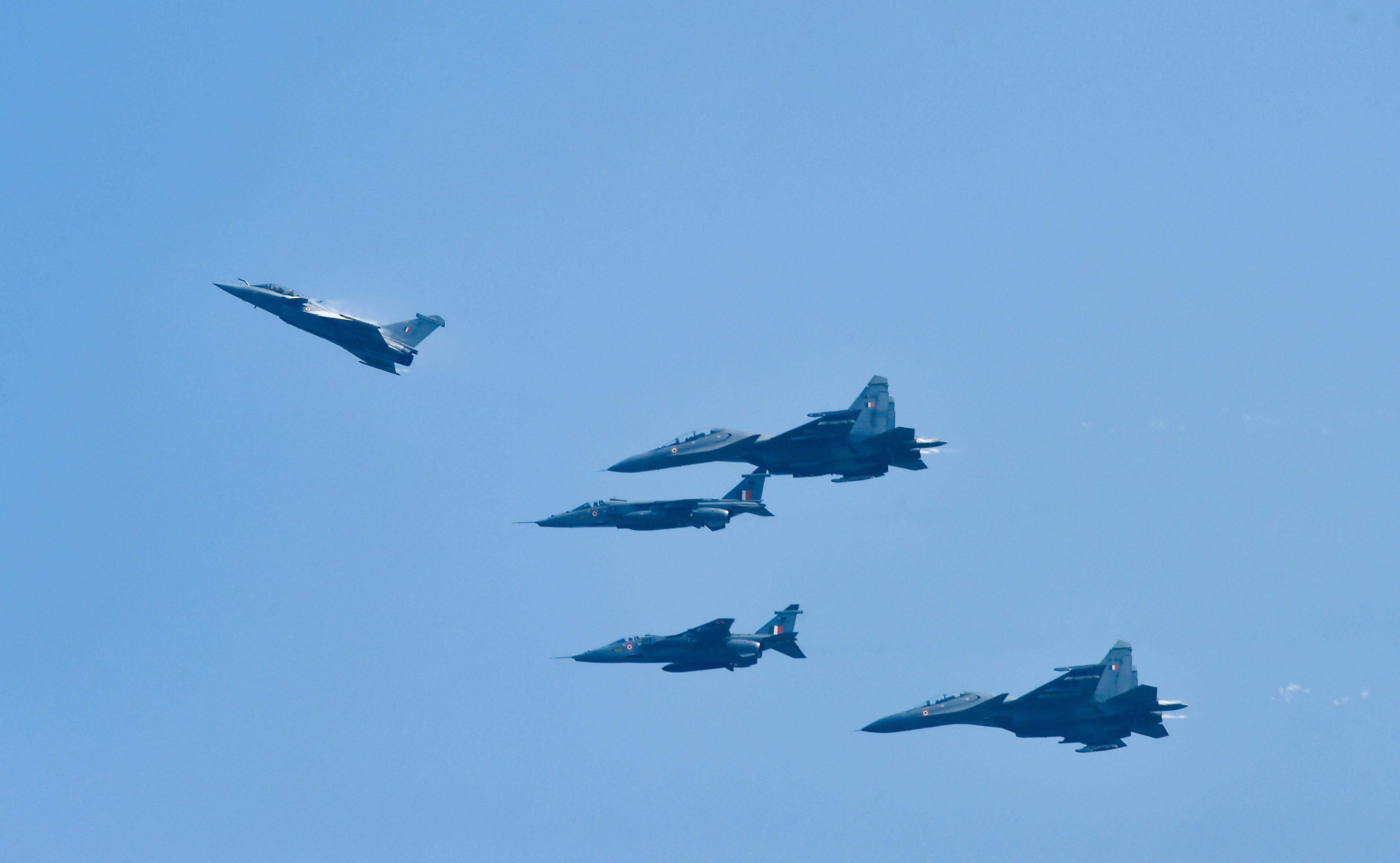 Rafale fighter aircraft flying at low-speed during an air display at Indian Air Force base in Ambala