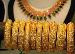 Gold prices fall by Rs 384 per ounce