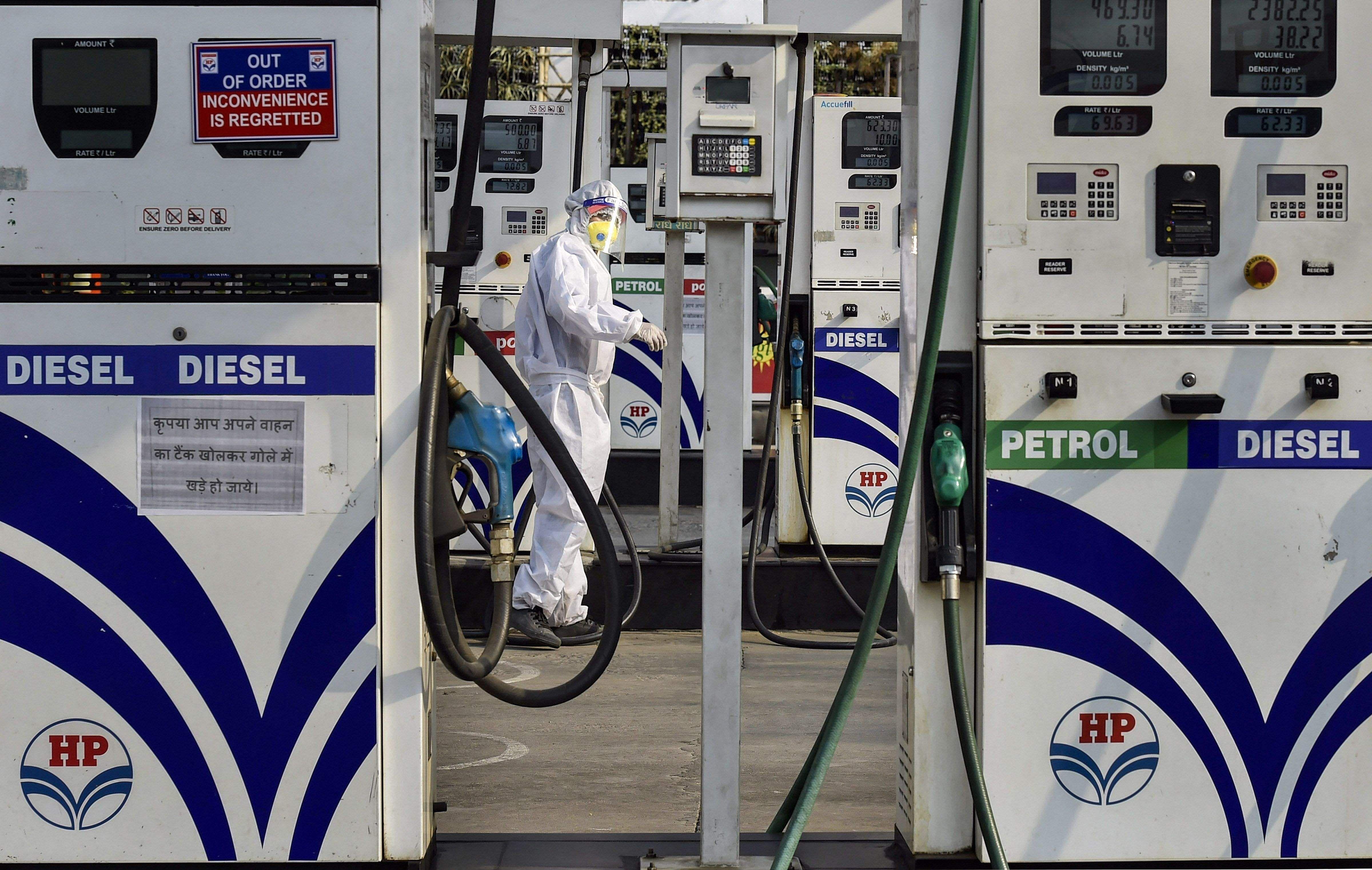 Remove photos of Modi on petrol stocks: Election Commission