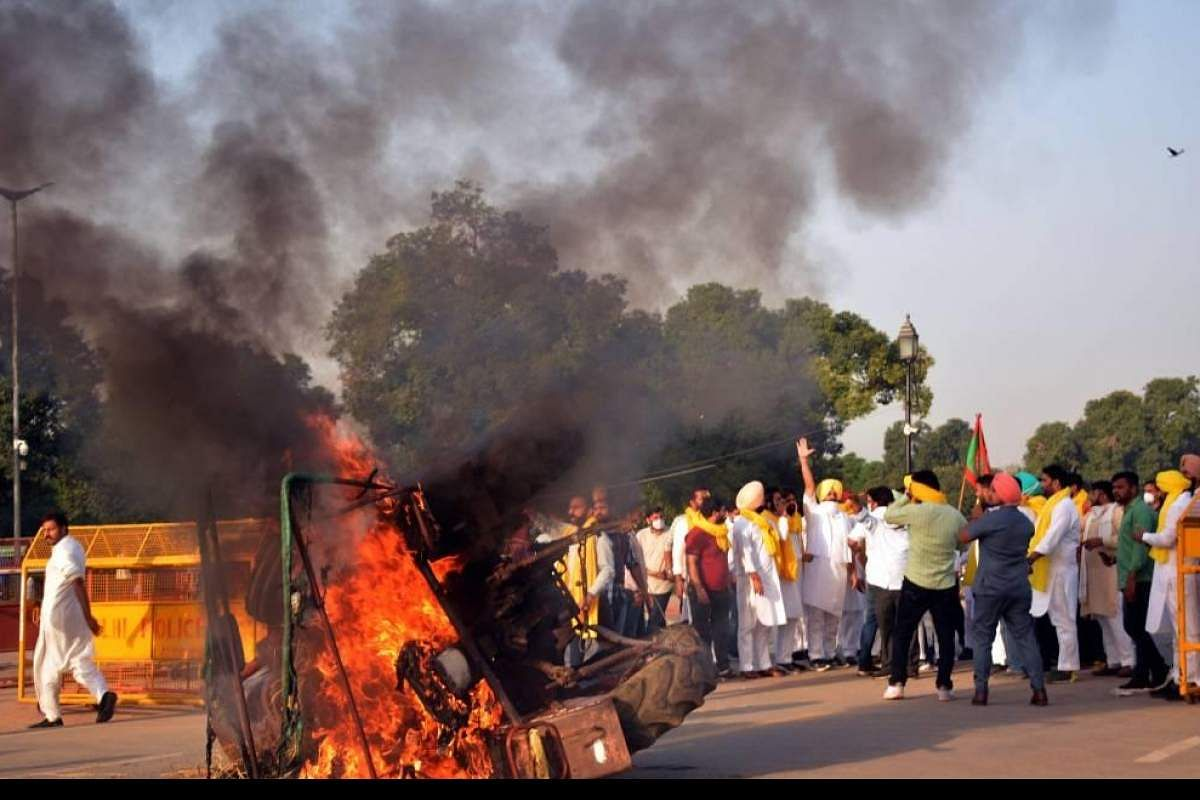 Punjab, Haryana farmers protest by burning copies of agricultural law